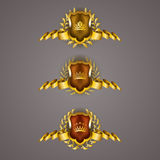 Golden shields with laurel wreath Stock Images