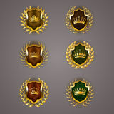 Golden shields with laurel wreath Royalty Free Stock Photos