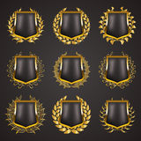 Golden shields with laurel wreath Royalty Free Stock Images