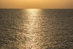 Golden shimmering Sea Water Stock Image
