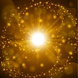 Golden shine with lens flare background Stock Images