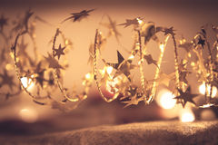 Golden shining stars garland with sparkling Christmas lights in golden colors in Christmas night as luxury Christmas background Stock Photography