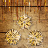 Golden shining tinsel and straw stars Stock Photo