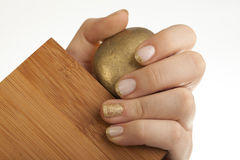 Golden shinny nails Stock Images