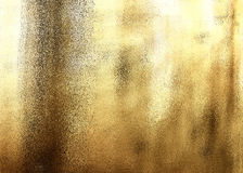 Golden shiny abstract metallic textured background Stock Images