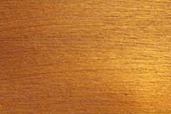 Golden shiny background. Bright golden background, sparkles and. Shines. A brush stroke Royalty Free Stock Photo