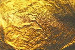 Golden shiny background. Bright golden background, sparkles and. Shines. A brush stroke.Foil Royalty Free Stock Image