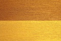 Golden shiny background. Bright golden background, sparkles and. Shines. A brush stroke Stock Images