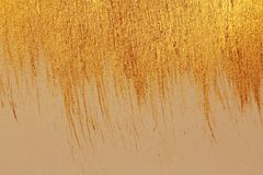 Golden shiny background. Bright golden background, sparkles and. Shines. A brush stroke Stock Photo