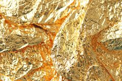 Golden shiny background. Bright golden background, sparkles and. Shines. A brush stroke.Foil Royalty Free Stock Photos