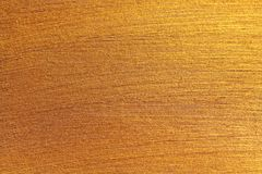 Golden shiny background. Bright golden background, sparkles and. Shines. A brush stroke Royalty Free Stock Images