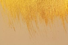 Golden shiny background. Bright golden background, sparkles and. Shines. A brush stroke Royalty Free Stock Image