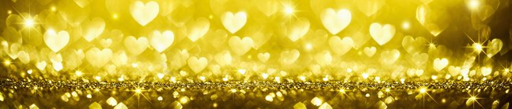 Golden Shiny Background with Hearts Stock Photos