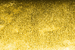 Golden shiny background with sparkles Stock Photos