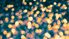 Abstract Golden shiny bokeh on light tinted background. Glowing background with bokeh style for seasonal greetings. stock photos