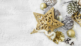 Golden Shiny Christmas Decorations in the Snow with Elegant Ribb Royalty Free Stock Photo