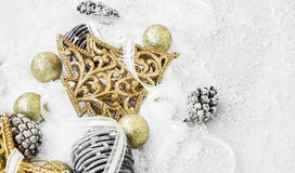 Golden Shiny Christmas Decorations in the Snow with Elegant Ribb Stock Photos