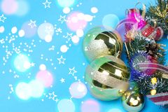 Golden Christmas baubles on blue background stock image
