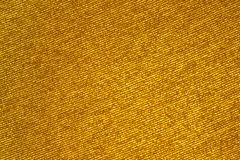 Golden shiny fabric, background or texture Royalty Free Stock Photo