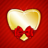 Golden shiny heart on red background Royalty Free Stock Photography