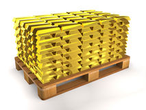 Golden shiny ingots on a wooden pallet. Royalty Free Stock Images