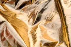 Golden shiny textile bakground Stock Images