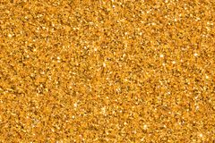 Golden shiny wallpaper, perfect for Christmas, New Year or any other Holidays background. stock photo