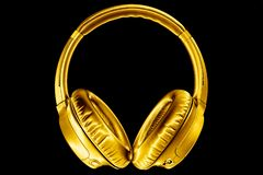 Free Golden Shiny Wireless Headphones On Black Background Isolated Closeup, Expensive Gold Metal Bluetooth Headset, Yellow Earphones Royalty Free Stock Photography - 166821327