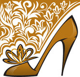Golden Shoe. S with high heels on  background with ornament Royalty Free Stock Photo