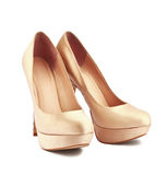 Golden shoes Stock Photo