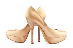 Golden shoes Stock Image