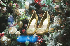 Golden shoes in Christmas tree, snow and decorations. Snow and decorations and golden shoes in Christmas tree Stock Photos