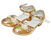 Golden shoes for girl Stock Photos