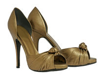 Golden shoes Stock Photography
