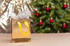 The golden shopping bag Stock Image