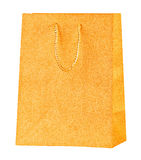 Golden shopping bag. Royalty Free Stock Images