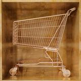 Golden shopping cart Royalty Free Stock Images