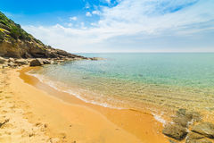 Golden shore in Solanas beach Royalty Free Stock Images