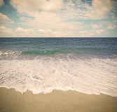 Golden shore under a cloudy sky in vintage tone Stock Image