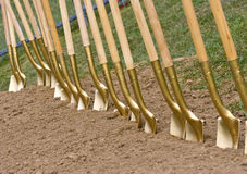 Golden Shovels. For groundbreaking event Stock Photos