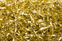 Golden shredded foil background Royalty Free Stock Photos