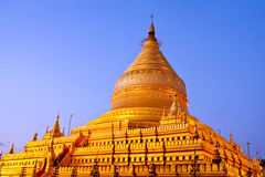 Golden Shwezigon Pagoda at sunrise in Bagan Archaeological zone, Royalty Free Stock Photo