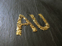 Golden sign. Natural placer gold nuggets with sign of aurum Stock Photography