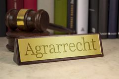 Golden sign with gavel and agricultural law stock images