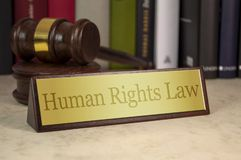 Golden sign with gavel and human rights law royalty free stock images