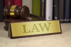 Golden sign with law stock image