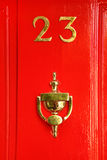 Golden sign on wooden door; 23 and cup Royalty Free Stock Photo