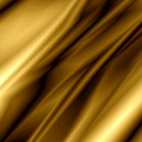 Golden silk. Multiple folds of a golden silk Royalty Free Stock Photos
