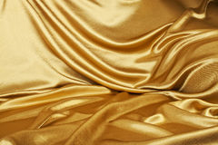 Golden silk. Smooth elegant golden silk can use as background Stock Images