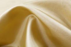 Golden silk background Stock Image